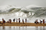 USA, Hawaii, Oahu, the North Shore, people watching enormous shorebreak and distant waves at Waimea Bay