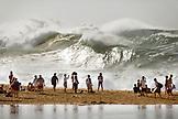 USA, Hawaii, Oahu, the North Shore, people watching enormous shorebreak and distant waves at Waimea Bay