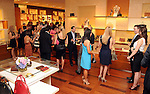 Guests enjoy themselves at an evening honoring The Houston Symphony Young Associates Council at the Louis Vuitton store in the Galleria Thursday August 15, 2013.(Dave Rossman photo)