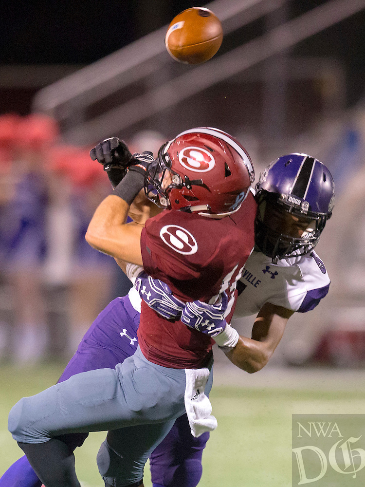 NWA Democrat-Gazette/JASON IVESTER<br /> Fayetteville's Trey Coulter breaks up a pass intended for Springdale's Alex Thompson on Friday, Oct. 28, 2016, at Jarrell Williams Bulldog Stadium in Springdale.