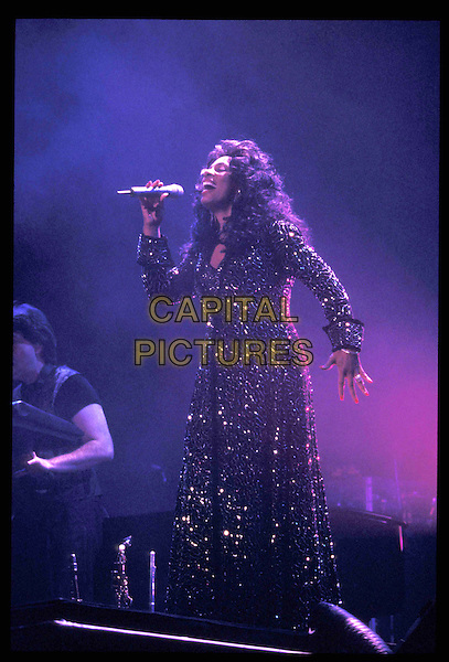 DONNA SUMMER.25 March 1996.Ref: 2357.singing, stage, concert, music, full length, full-length.*RAW SCAN- photo will be adjusted for publication*.www.capitalpictures.com.sales@capitalpictures.com.©Capital Pictures