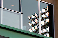 The stadium lights at Hammons Field are reflected in the windows during a game between the Tulsa Drillers and the Springfield Cardinals at Hammons Field on July 19, 2011 in Springfield, Missouri. Tulsa defeated Springfield 17-11. (David Welker / Four Seam Images)
