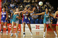 """20.03.2010 Mystics Maria Tutaia and Thunderbirds Georgia Beaton and Mo'onia Gerrard in action during the ANZ Champs Netball match between the Mystics and Thunderbirds at Trusts Stadium in Auckland. Mandatory Photo Credit ©MBPHOTO. """"FREE FOR EDITORIAL USE"""""""