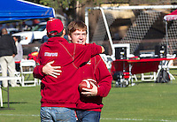 Scott Livingston ( face to camera ) a Stanford student plays football  before  Saturday, November 23, 2013, Big Game at Stanford University.
