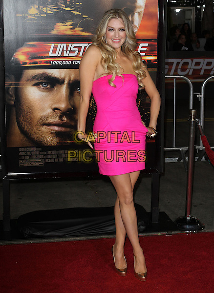 "ERIKA JAYNE .Los Angeles Premiere Of ""Unstoppable"" held at Regency Village Theatre, Westwood, CA, USA, 26th October 2010..Full length pink dress hands on hips strapless gold shoes .CAP/ADM/KB.©Kevan Brooks/AdMedia/Capital Pictures."