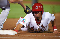 Springfield Cardinals first baseman Jonathan Rodriguez (28) dives back to first during a game against the Frisco RoughRiders  on June 4, 2015 at Hammons Field in Springfield, Missouri.  Frisco defeated Springfield 8-7.  (Mike Janes/Four Seam Images)