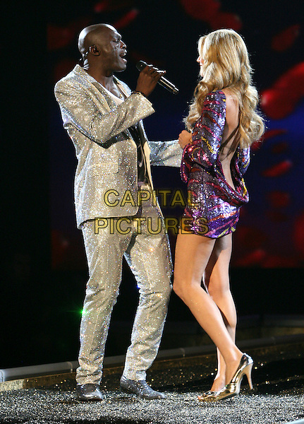 SEAL & HEIDI KLUM.The 2007 Victoria's Secret Fashion Show held at The Kodak Theatre in Hollywood, California, USA..November 15th, 2007 .full length microphone married husband wife sequins sequined dress pink yellow silver holding hands jacket silver suit backless singing stage concert live gig performance music .CAP/DVS.©Debbie VanStory/Capital Pictures