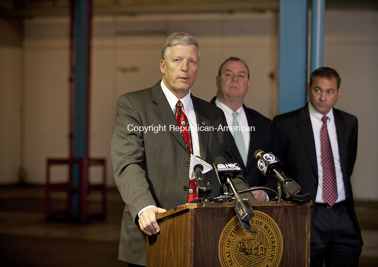 WATERBURY, CT-15 NOVEMBER 2013-111513BF04- Consultant Matt Cook discusses the plan for a medical marijuana facility as Waterbury Mayor Neil M. O'Leary and Tom Macre Executive Director of C-Three look on during a press conference at the site Friday morning. The proposed 70,000 square-foot site on East Aurora Street in Waterbury  will house two separate companies at the site to grow and distribute medical marijuana. Bob Falcetti Republican-American