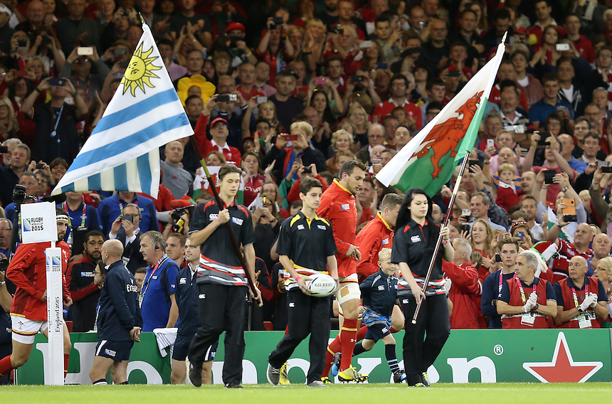 Wales' Sam Warburton (c) leads his team out onto the field at the start of the game <br /> <br /> Photographer Ian Cook/CameraSport<br /> <br /> Rugby Union - 2015 Rugby World Cup - Wales v Uruguay - Sunday 20th September 2015 - Millennium Stadium - Cardiff<br /> <br /> &copy; CameraSport - 43 Linden Ave. Countesthorpe. Leicester. England. LE8 5PG - Tel: +44 (0) 116 277 4147 - admin@camerasport.com - www.camerasport.com