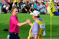 Justin Thomas (USA) and his caddie shake hands after Thomas sunk his final putt of the day to win the PGA Championship at the Quail Hollow Club in Charlotte, North Carolina. 8/13/2017.<br /> Picture: Golffile | Ken Murray<br /> <br /> <br /> All photo usage must carry mandatory copyright credit (&copy; Golffile | Ken Murray)