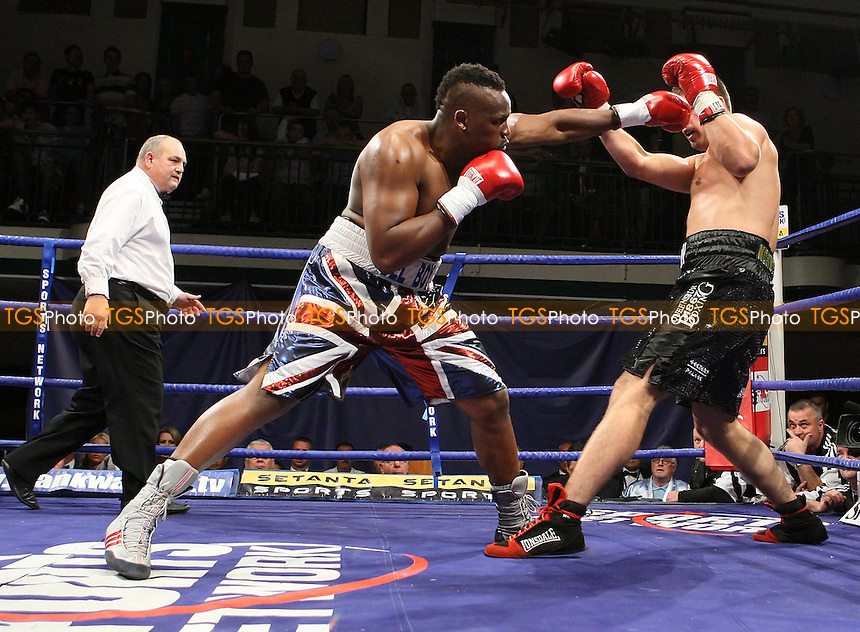 Derk Chisora (Finchley, union jack shorts) defeats Sam Sexton (Norwich, black shorts) in a Heavyweight contest at York Hall, Bethnal Green, promoted by Frank Warren, Sports Network - 14/06/08 - MANDATORY CREDIT: Gavin Ellis/TGSPHOTO. Self-Billing applies where appropriate. NO UNPAID USE. Tel: 0845 094 6026