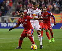 Harrison, NJ - Thursday March 01, 2018: Michael Chirinos, Tyler Adams. The New York Red Bulls defeated C.D. Olimpia 2-0 (3-1 on aggregate) during a 2018 CONCACAF Champions League Round of 16 match at Red Bull Arena.