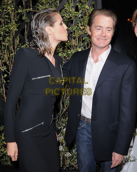 HEIDI KLUM & KYLE MACLACHLAN.The Eva by Eva Longoria Fragrance Launch held at Beso in Hollywood, California, USA. .April 27th, 2010.perfume half length black wet hair blue suit jacket pink white shirt puckering lips kiss blow blowing funny gesture slicked back coat jacket zip zippers dress shoulder pads long sleeves profile .CAP/RKE/DVS.©DVS/RockinExposures/Capital Pictures.