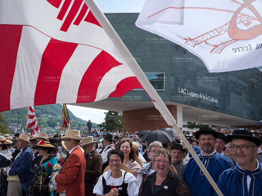 Switzerland. Ticino. Lugano. MASI LAC.  LAC Lugano Arte e Cultura. Federal Choir Festival in Costume. The beauty and tradition of costumes from all regions of Switzerland. A flag from the Canton Bern. LAC Lugano Arte e Cultura is a new cultural centre dedicated to the visual arts, music and the performing arts. 12.06.2016 © 2016 Didier Ruef