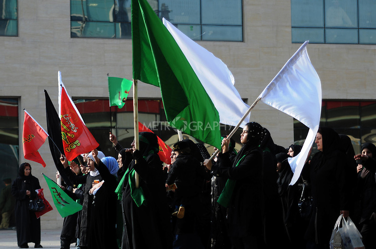IRAQ, SULAIMANIYAH:  Women march behind the men as part of the Shia holiday of Ashura...Around 500 hundred worshipers, many of them internally displaced Arabs, celebrated the Shia holiday of Ashura--the mourning of the death of the grandson of the Islamic prophet Mohammed.  ..Photo by Kamaran Najm/Metrography