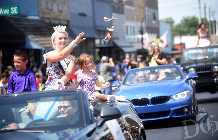 NWA Democrat-Gazette/FLIP PUTTHOFF <br /> GRAVETTE DAY PARADE<br /> Darlene McVay, Miss Gravette 2018, tosses candy during the parade Saturday Aug. 10 2019 at the 126th annual Gravette Day. The parade along Main Street featured the Gravette Lions marching band, football team, cheerleaders and other groups, plus an array of emergency responder vehicles. A car show, Dutch oven cook-off and arts and crafts were part of the annual gathering.