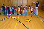 MR / Schenectady, NY. Zoller Elementary School (urban public school). Kindergarten inclusion classroom. Students line up in front of their teacher in school gym after completing physical education class. MR: War15. ID: AM-gKw. © Ellen B. Senisi.