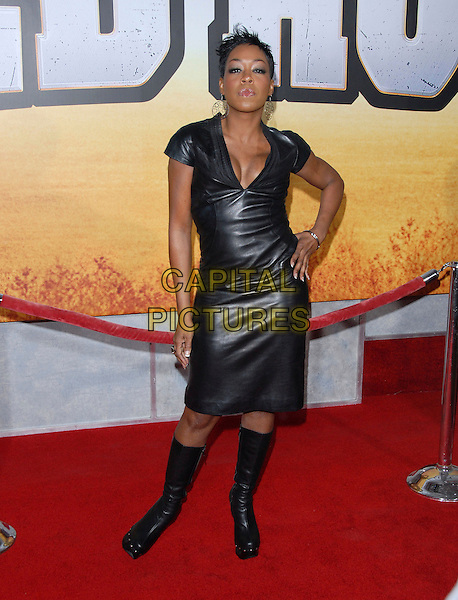 "TICHINA ARNOLD.attends The Touchstone Pictures' World Premiere of ""Wild Hogs"" held at The El Capitan Theatre in Hollywood, California, USA, February 27 2007. .full length black leather dress hand on hip boots.CAP/DVS.©Debbie VanStory/Capital Pictures"