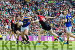 James O'Donoghue Kerry in action against Chris Barrett and Paddy Durkin Mayo in the All Ireland Semi Final Replay in Croke Park on Saturday.