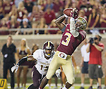 Florida State wide receiver Jesus Wilson makes a touchdown catch in front of Texas State defensive back Dila Roseman in the second half of an NCAA college football game in Tallahassee, Fla., Saturday, Sept. 5, 2015.  Florida State defeated Texas State 59-16. (AP Photo/Mark Wallheiser)