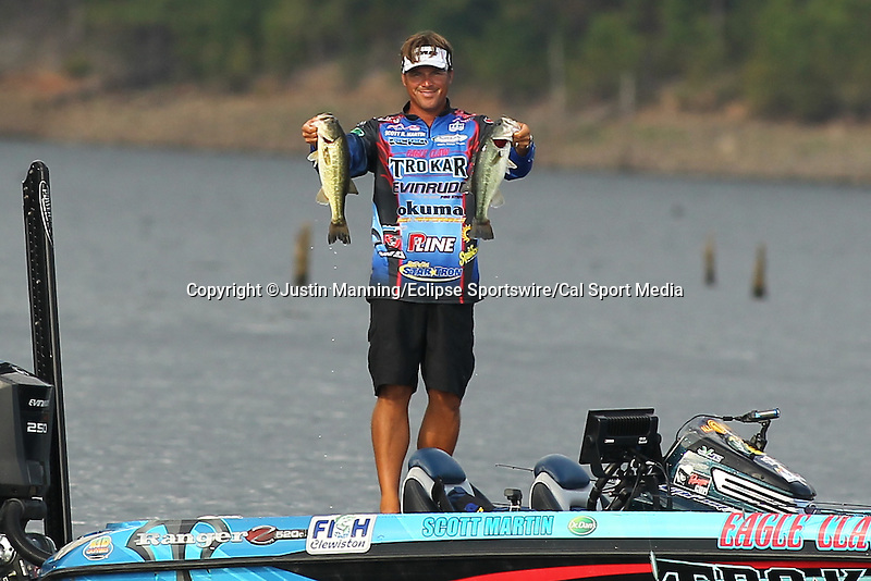 August 22, 2015: Scott Martin holds up two nice keeper fish on day three of the Forrest Wood Cup on Lake Ouachita in Hot Springs, AR. Justin Manning/ESW/CSM