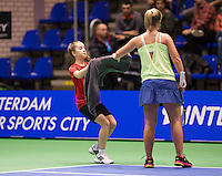December 21, 2014, Rotterdam, Topsport Centrum, Lotto NK Tennis, Richel Hogenkamp gets a zowel from a ballgirl<br /> Photo: Tennisimages/Henk Koster