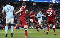 Manchester City's Leroy Sane shoots despite the attentions of Liverpool's Alex Oxlade-Chamberlain<br /> <br /> Photographer Rich Linley/CameraSport<br /> <br /> UEFA Champions League Quarter-Final Second Leg - Manchester City v Liverpool - Tuesday 10th April 2018 - The Etihad - Manchester<br />  <br /> World Copyright &copy; 2017 CameraSport. All rights reserved. 43 Linden Ave. Countesthorpe. Leicester. England. LE8 5PG - Tel: +44 (0) 116 277 4147 - admin@camerasport.com - www.camerasport.com