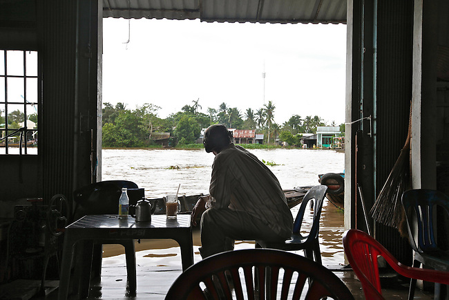 A coffee shop is flooded in the town of Cai Rang, in the Mekong Delta, Vietnam. Sept. 30, 2011.