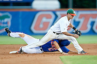 June 12, 2010:    Florida Outfielder Matt den Dekker (17) slides in under the tag of Miami Infielder Stephen Perez (4) during game two of NCAA Gainesville Super Regional action between the University of Florida Gators and Miami Hurricanes at Alfred A. McKethan Stadium on the campus of University of Florida in Gainesville.   Florida defeated Miami in 10 innings 4-3 to advance to the College World Series in Omaha, Nebraska...........