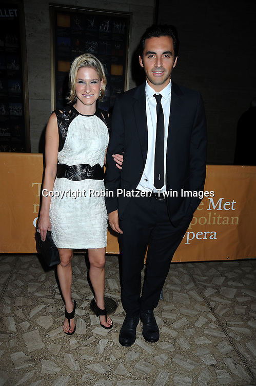 Julie Macklowe and Yigal Azrouel posing for photographers at The Metropolitan Opera Fall 2010 Season Opening of Das Rheingold on September 27, 2010 at the Metropolitan Opera House in Lincoln Center in New York City. .