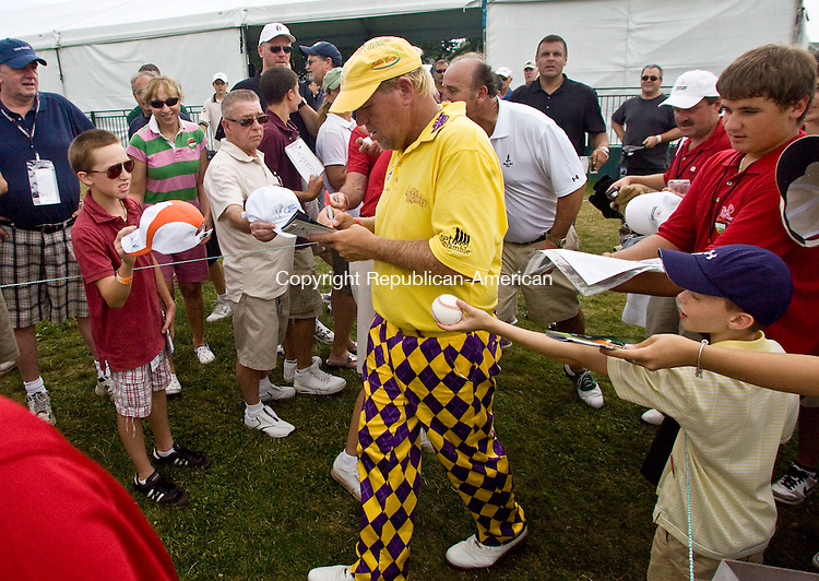 CROMWELL, CT - 23 JUNE 2010 -062310JT02-<br /> John Daly signs autographs for fans after finishing a round of golf during Wednesday's Travelers Celebrity Pro-Am golf event at TPC River Highlands in Cromwell.<br /> Josalee Thrift Republican-American