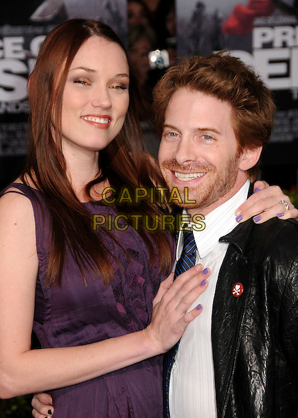 "CLARE GRANT & SETH GREEN.""Prince Of Persia: The Sands Of Time"" Los Angeles Premiere held at Grauman's Chinese Theatre, Hollywood, California, USA..May 17th, 2010.half length shirt tie beard facial hair blue leather arm around waist nail varnish polish black white purple dress couple tall short.CAP/ADM/BP.©Byron Purvis/AdMedia/Capital Pictures."