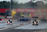 Sept. 6, 2010; Clermont, IN, USA; NHRA top fuel dragster driver T.J. Zizzo (left) defeats Doug Kalitta in the first round during the U.S. Nationals at O'Reilly Raceway Park at Indianapolis. Mandatory Credit: Mark J. Rebilas-