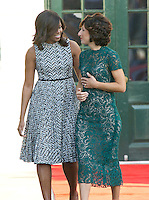 First lady Michelle Obama escorts Mrs. Agnese Landini of Italy to the Official Arrival Ceremony in honor of the visit of Prime Minister Matteo Renzi of Italy on the South Lawn of the the White House in Washington, DC on Tuesday, October 18, 2016. <br /> Credit: Ron Sachs / CNP /MediaPunch
