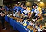Riders have dinner at the Journey of Hope event at Western Nevada College in Carson City, Nev., on Friday, June 12, 2015. Nearly 30 cyclist rode into town Friday as part of the Pi Kappa Phi fraternity&rsquo;s cross-country ride to bring awareness and support to people with disabilities.<br /> Photo by Cathleen Allison/Nevada Photo Source