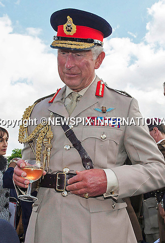 05.06.2014; Normandy, FRANCE: PRINCE CHARLES<br /> meeting veterans of the Parachute Regiment in Breville-les-Monts.<br /> He attended a parade in Breville-les-Monts after watching Parachutists landing on a Drop Zone as part of the D-Day remembrance services.<br /> The Prince of Wales is Colonel in Chief of The Parachute Regiment.<br /> Mandatory Credit Photo: &copy;Peters-Crown Copyright/NEWSPIX INTERNATIONAL<br /> <br /> **ALL FEES PAYABLE TO: &quot;NEWSPIX INTERNATIONAL&quot;**<br /> <br /> IMMEDIATE CONFIRMATION OF USAGE REQUIRED:<br /> Newspix International, 31 Chinnery Hill, Bishop's Stortford, ENGLAND CM23 3PS<br /> Tel:+441279 324672  ; Fax: +441279656877<br /> Mobile:  07775681153<br /> e-mail: info@newspixinternational.co.uk