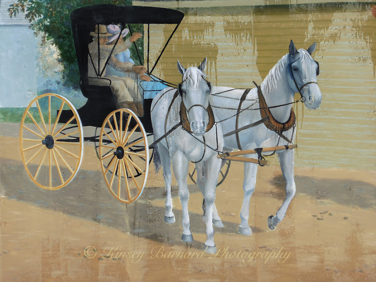 Horse and buggy mural found on Main Street in Sheridan, Wyoming. The horses look like they are about to walk right off the wall.