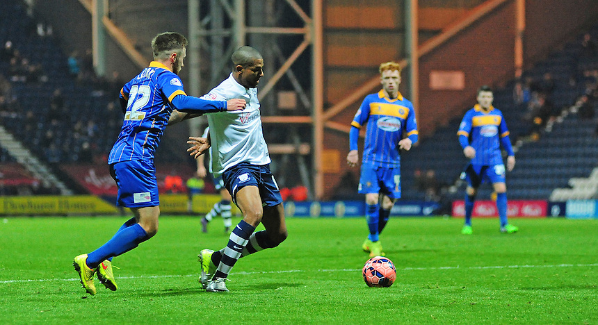 Preston North End&rsquo;s Jermaine Beckford shields the ball from Shrewsbury Town's Jordan Clark<br /> <br /> Photographer Chris Vaughan/CameraSport<br /> <br /> Football - FA Challenge Cup Second Round - Preston North End v Shrewsbury Town - Saturday 6th December 2014 - Deepdale - Preston<br /> <br />  &copy; CameraSport - 43 Linden Ave. Countesthorpe. Leicester. England. LE8 5PG - Tel: +44 (0) 116 277 4147 - admin@camerasport.com - www.camerasport.com