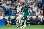 Arnaldo Antonio Sanabria Ayala (r) of Real Betis fights for the ball with Sergio Ramos of Real Madrid during the La Liga 2017-18 match between Real Madrid and Real Betis at Estadio Santiago Bernabeu on 20 September 2017 in Madrid, Spain. Photo by Diego Gonzalez / Power Sport Images