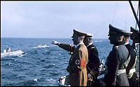 BNPS.co.uk (01202 558833)<br /> Pic: SAS/BNPS<br /> <br /> Hitler salutes the U-Boat fleet from the deck of the Grille.<br /> <br /> Adolf Hitler's personal standard that was flown on his luxurious yacht until it was seized by a souvenier-hunting Royal Navy seaman has emerged for sale.<br /> <br /> Signalman Jack Lee removed the highly sought-after Nazi swastika flag after the vessel, called the Grille, was taken over by the navy at the end of the Second World War.<br /> <br /> SM Lee found the 39ins by 67ins red and black flag that had been hidden on board by the German crew.<br /> <br /> Accompanying the flag is a remarkable letter from his describing the luxurious surroundings if thee 443ft long yacht.