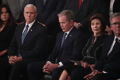 U.S. Vice President Mike Pence looks over at former President George W. Bush as he sits with former first lady Laura Bush at a memorial service for his father former President George H.W. Bush in the U.S. Capitol Rotunda in Washington, U.S., December 3, 2018. REUTERS/Jonathan Ernst/Pool