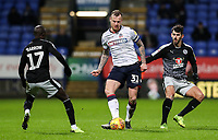 Bolton Wanderers' David Wheater competing with Reading's Modou Barrow and Nelson Oliveira<br /> <br /> Photographer Andrew Kearns/CameraSport<br /> <br /> The EFL Sky Bet Championship - Bolton Wanderers v Reading - Tuesday 29th January 2019 - University of Bolton Stadium - Bolton<br /> <br /> World Copyright © 2019 CameraSport. All rights reserved. 43 Linden Ave. Countesthorpe. Leicester. England. LE8 5PG - Tel: +44 (0) 116 277 4147 - admin@camerasport.com - www.camerasport.com