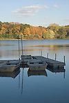 Sauk Trail State Park, Annawan, Illinois; row boats tied to the dock with fall colors in the leaves of the trees in the background
