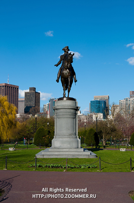 George Washington statue In Boston Public Garden in a sunny spring day over bright blue sky