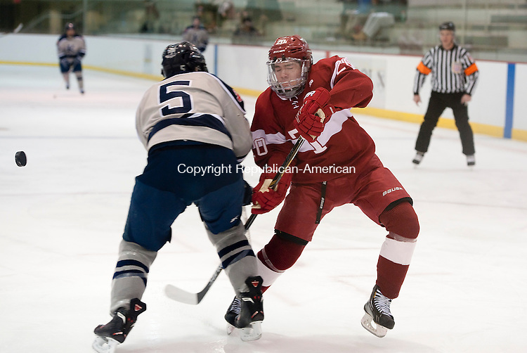 WATERTOWN,  CT-020415JS09- Taft's Carter Taft (20) collides with Kent's Keanu Hilaire (5) during their game Wednesday at Oden Rink on the Taft campus in Watertown. <br /> Jim Shannon Republican-American