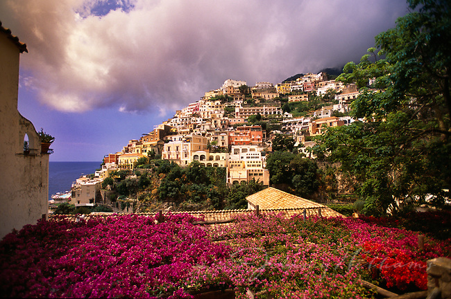 A view of the Amalfi Coast of Italy from a beautiful garden filled with colorful flowers