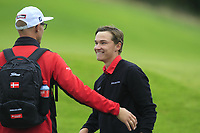 Rasmus Hojgaard of Team Denmark holes for a birdie on the 18th green and celebrates as Denmark win during Round 4 of the WATC 2018 - Eisenhower Trophy at Carton House, Maynooth, Co. Kildare on Saturday 8th September 2018.<br /> Picture:  Thos Caffrey / www.golffile.ie<br /> <br /> All photo usage must carry mandatory copyright credit (© Golffile | Thos Caffrey)
