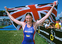 10 NOV 2002 - CANCUN, MEX - Britain's Leanda Cave celebrates becoming the first British woman to win the elite womens title at an ITU World Triathlon Championships (PHOTO (C) NIGEL FARROW)