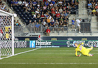 CHESTER, PA - AUGUST 12, 2012:  Zac MacMath (18) of the Philadelphia Union is beaten by a long range shot from Chris Rolfe (18) of the Chicago Fire for the Fire's third goal during an MLS match at PPL Park, in Chester, PA on August 12. Fire won 3-1.