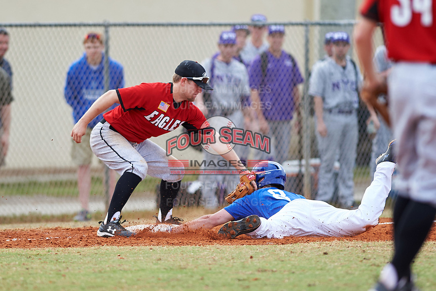 Edgewood College Eagles Tim Nunn (12) tags Austin Gusewelle (8) during a game against the Illinois College Blueboys on March 14, 2017 at Terry Park in Fort Myers, Florida.  Edgewood defeated Illinois College 11-2.  (Mike Janes/Four Seam Images)